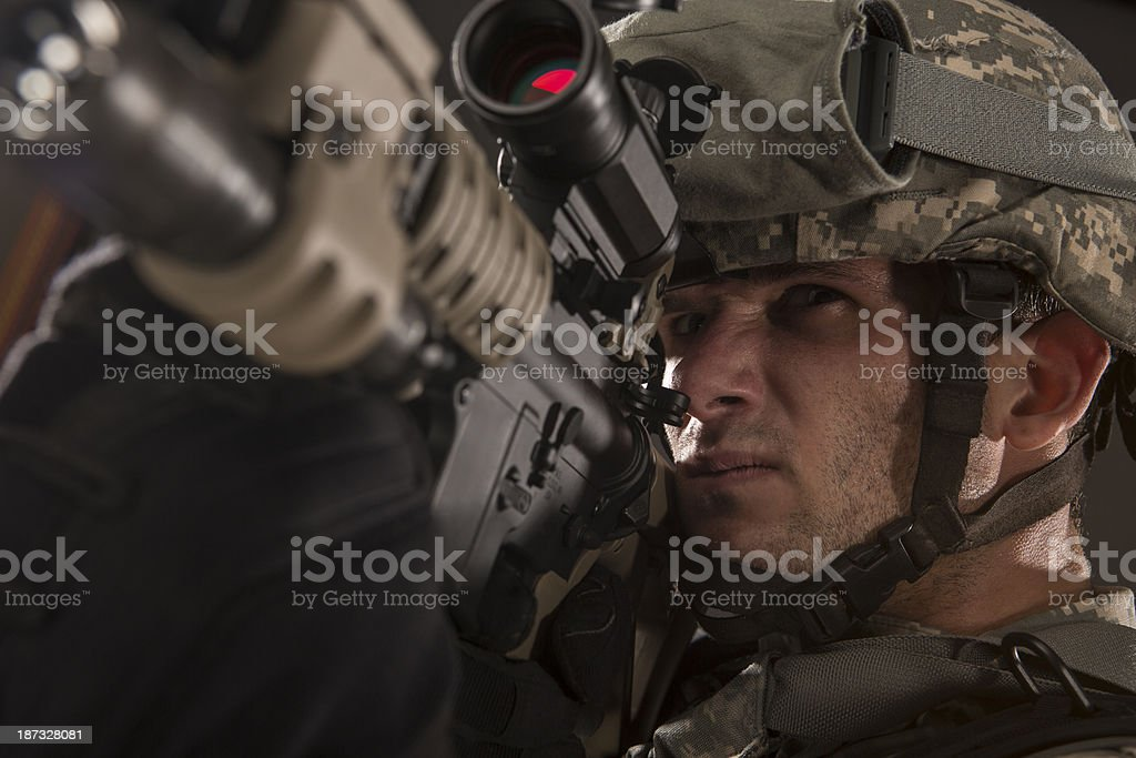 Military Sniper prepares to take a shot royalty-free stock photo
