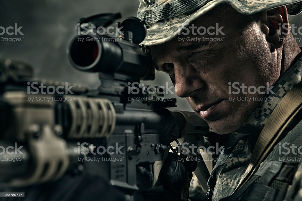 Military Sniper prepares to take a shot stock photo