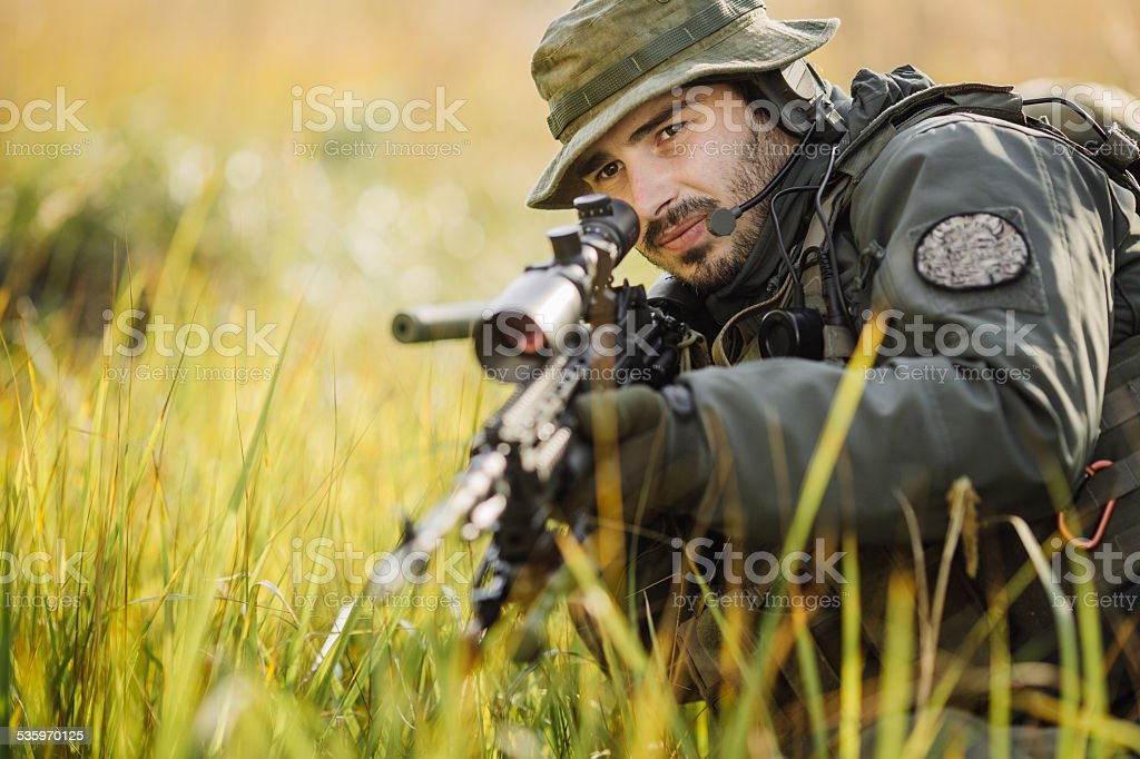 military soldier aiming an assault rifle stock photo