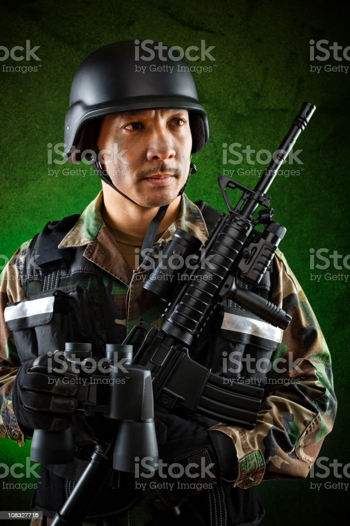 military soldier holding binoculars and rifle royalty-free stock photo