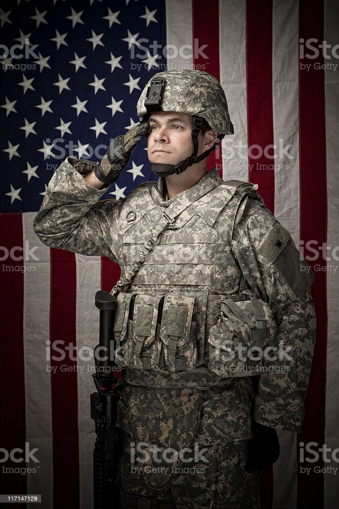 Military Soldier in front of American Flag stock photo