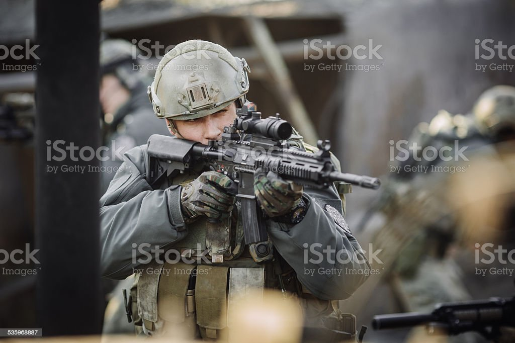 military soldier shooting an assault rifle stock photo