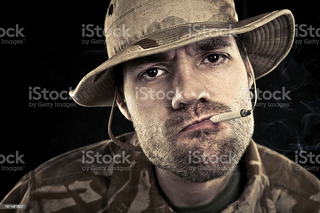 Military Soldier Smoking A Cigarette royalty-free stock photo