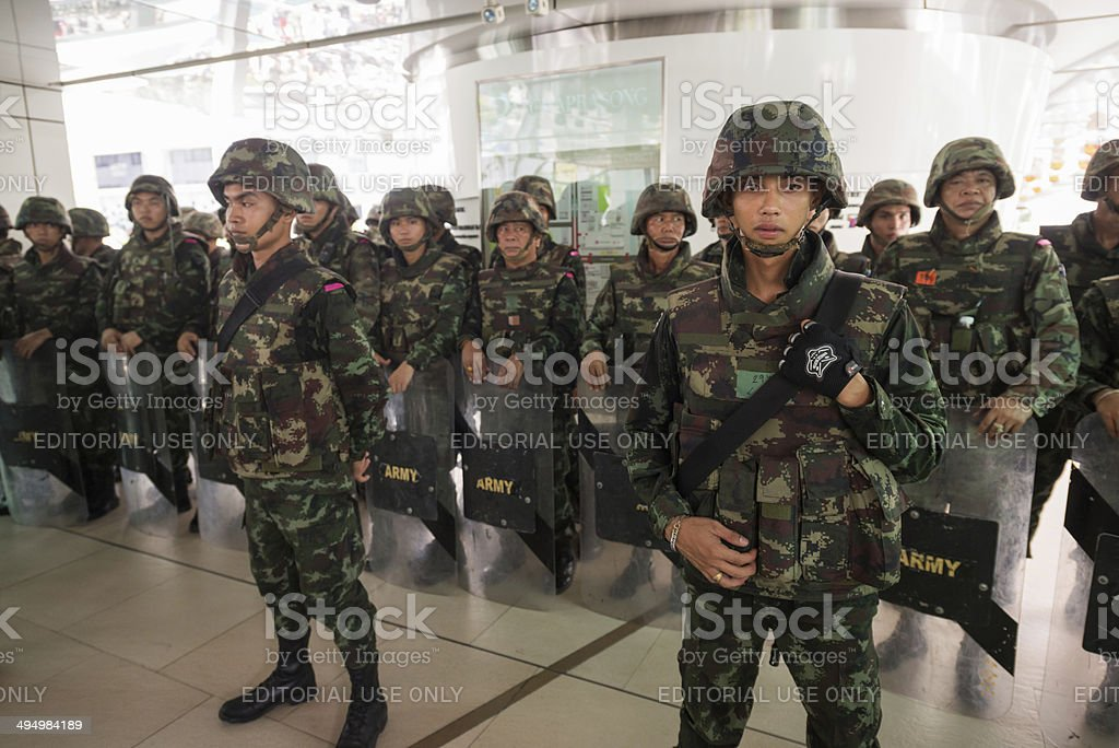 Military soldier wall blocking skywalk stock photo