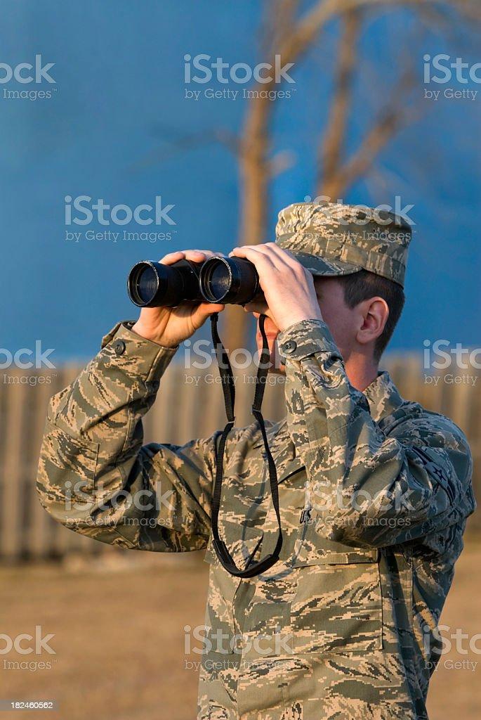 Military Soldier with Binoculars at Sundown stock photo