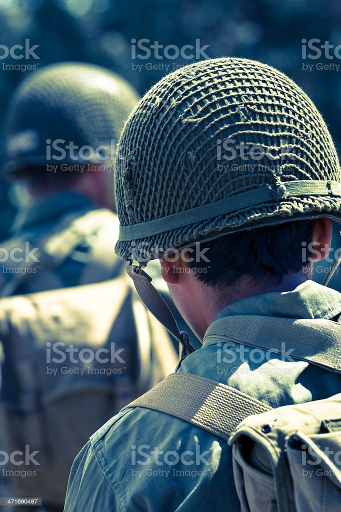 Military soliders in uniform fatigues during combat royalty-free stock photo