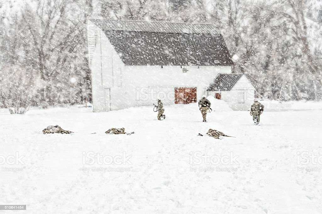 WWII US Military Squadron Taking Fire During A Snow Storm stock photo