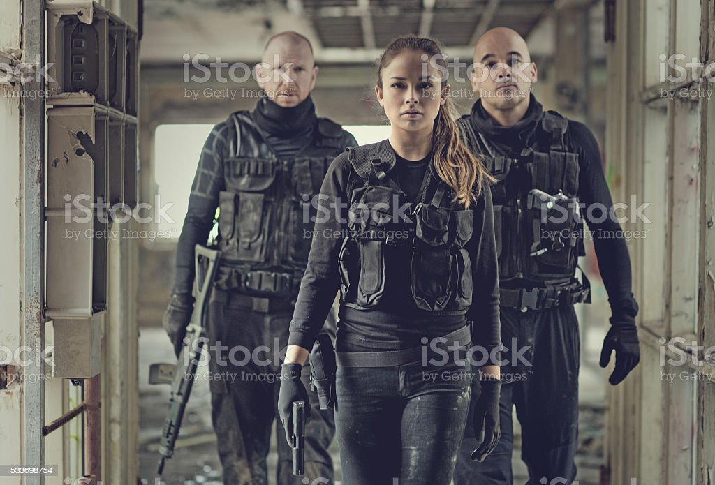 Military swat team members during operation in abandoned warehouse stock photo
