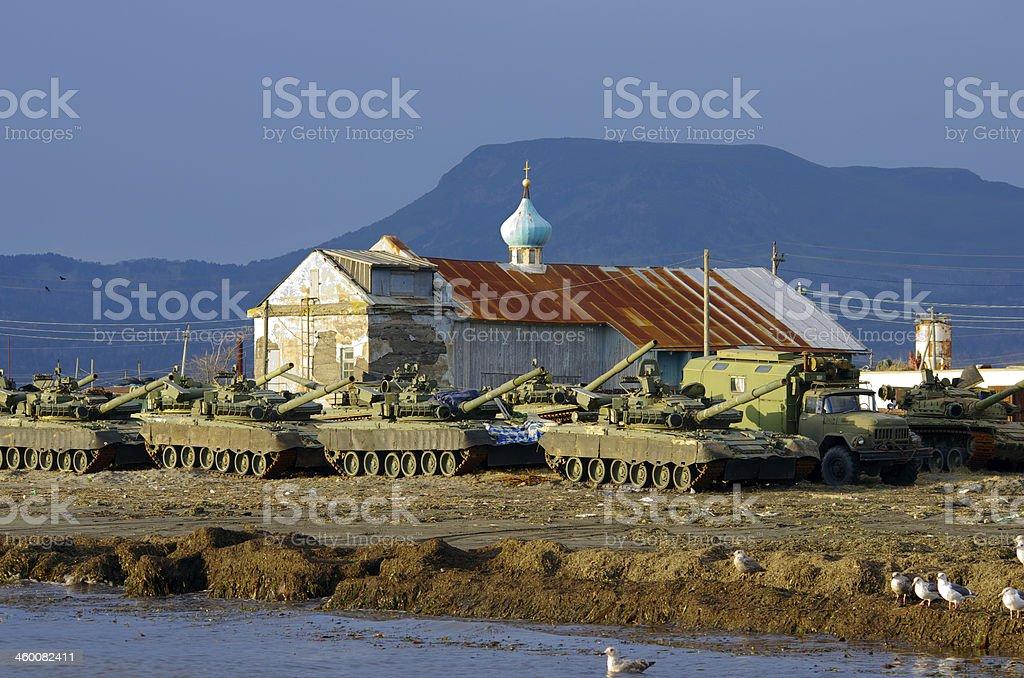 Military tanks and church stock photo