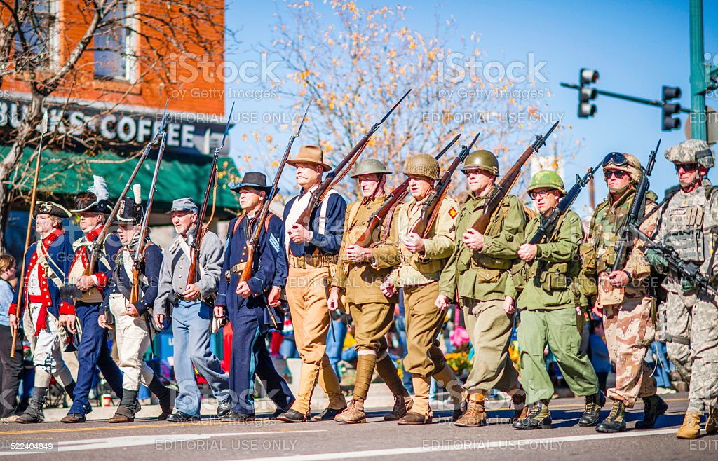 US military through the ages in Veterans Day Parade stock photo