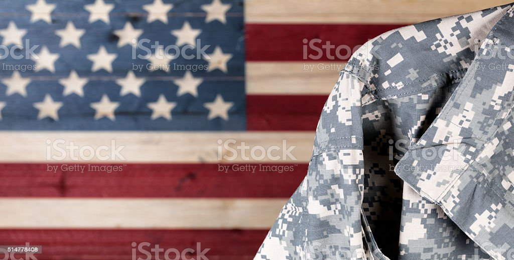 Military uniform with faded boards painted in American USA flag stock photo