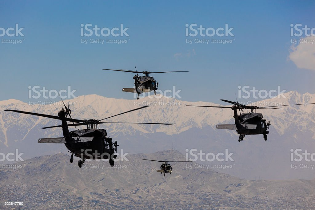 Military utility helicopter in Flight stock photo