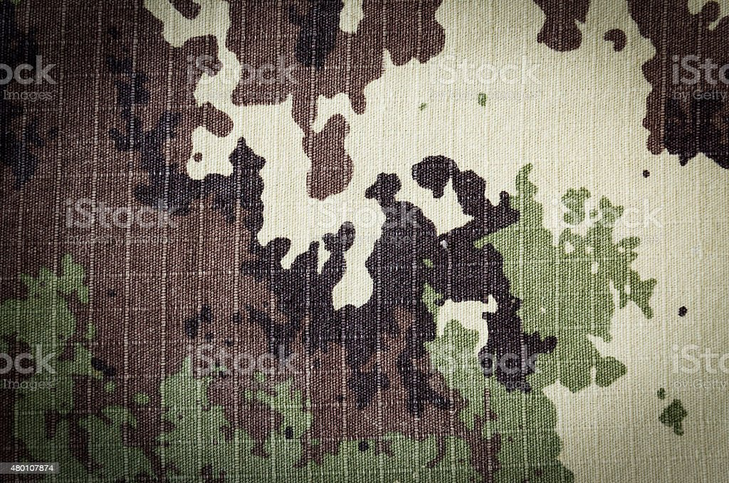 Military vegetato camouflage rip-stop fabric texture background stock photo