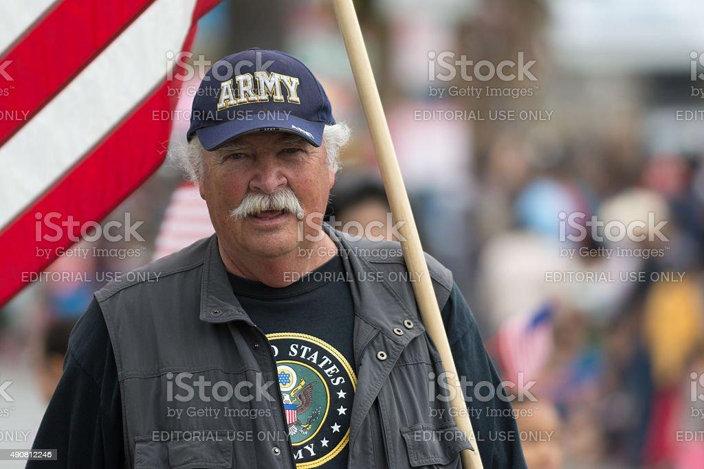 Military veteran holding flag stock photo