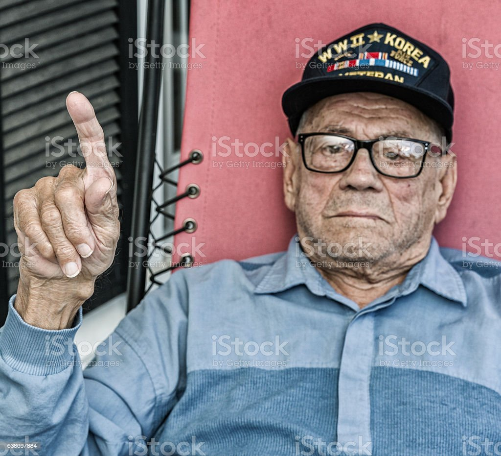 WWII USA Military Veteran Number One Index Finger Hand Gesture stock photo