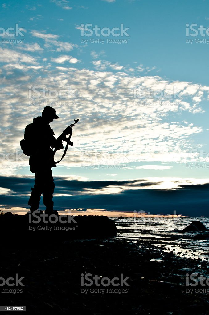 military water, rocky shore stock photo