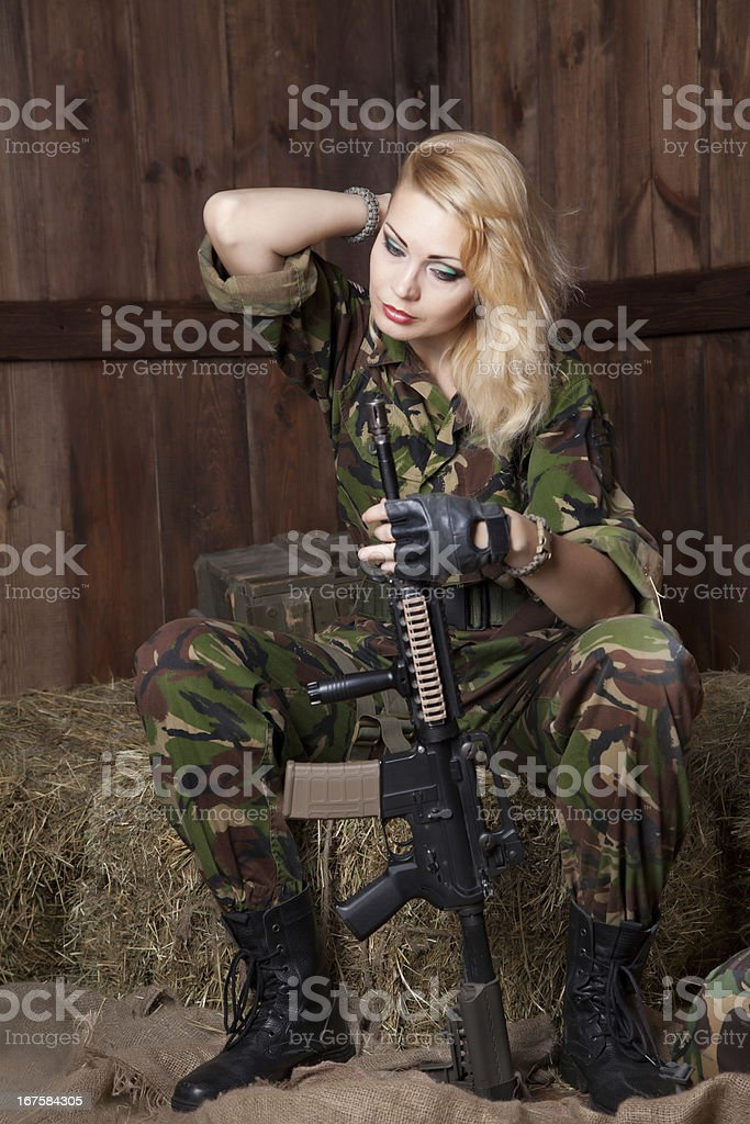 Military woman with a weapon royalty-free stock photo