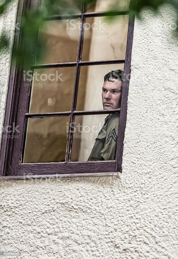 Military World War Two US Army Corporal Soldier Through Window stock photo