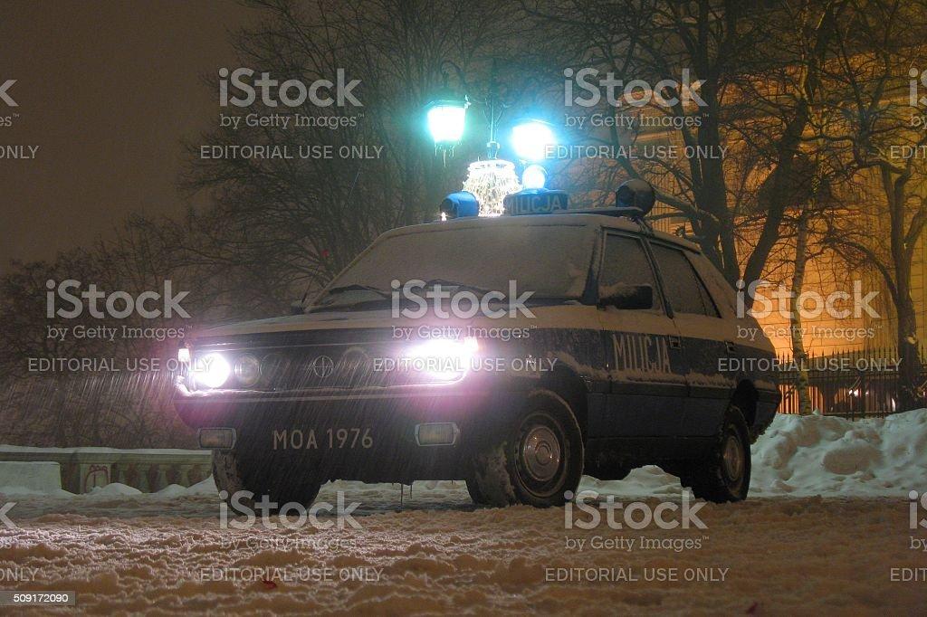Militia car on the street at night stock photo