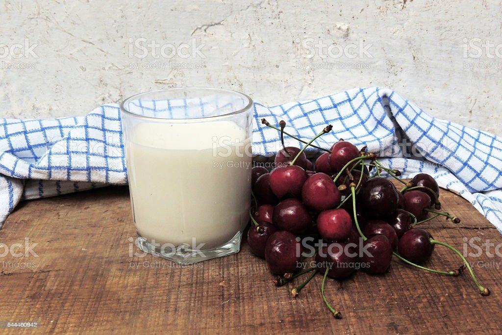 Milk and cherries stock photo