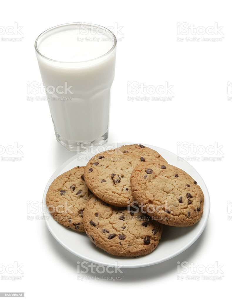 Milk and chocolate chip cookies on white background stock photo