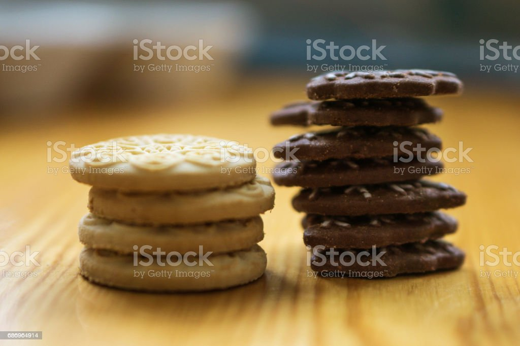 Milk and chocolate cookies on the kitchen table stock photo