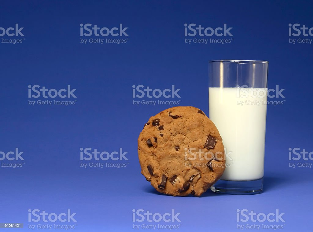 Milk and Cookie on Blue stock photo