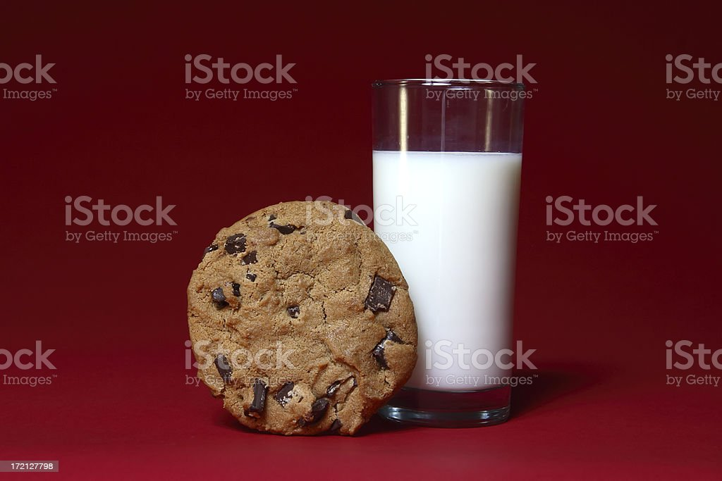 Milk and Cookie on Red stock photo