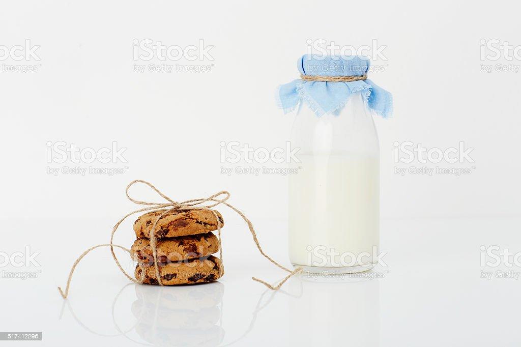 Milk and cookies in white studio stock photo