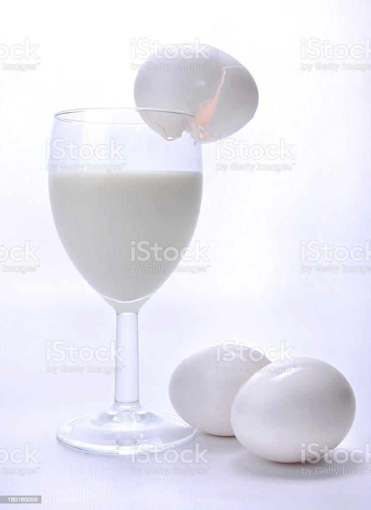 Milk and Eggs in a Wine Glass royalty-free stock photo