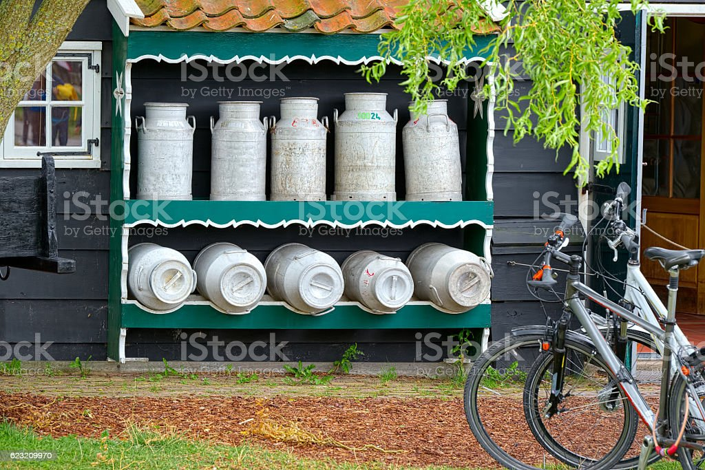 Milk and typical bike in a Dutch village (Zaandam) stock photo