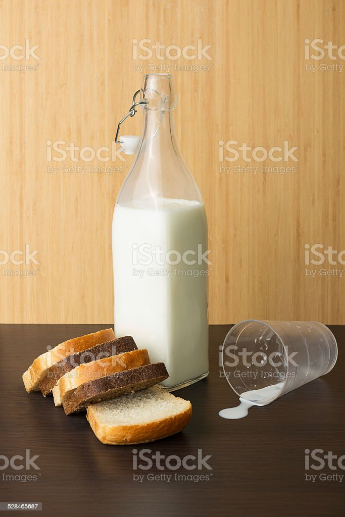 Milk bottle and bread stock photo