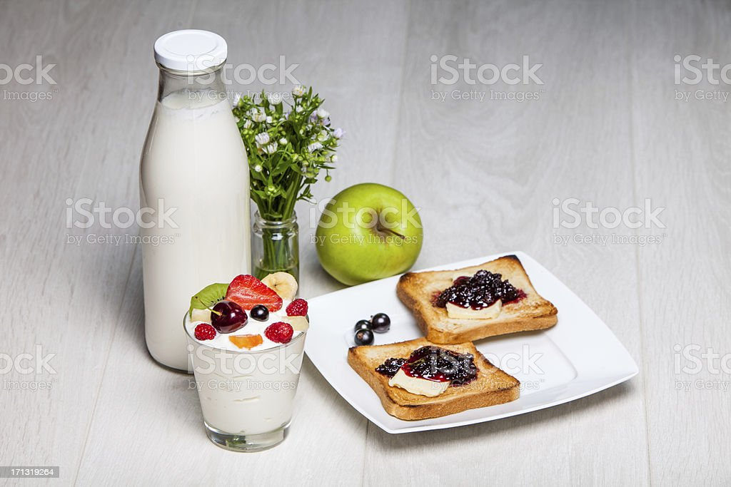 milk bottle and glass of yogurt with toasts stock photo