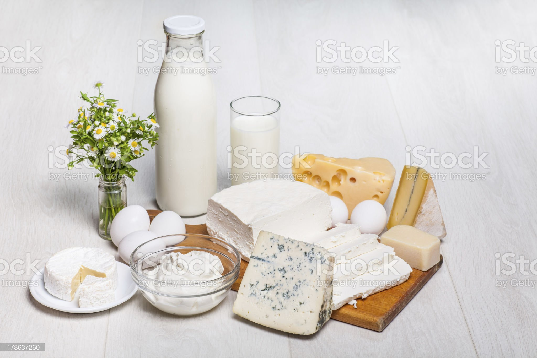 milk bottle and glass on wooden background, cottage cheese, eggs royalty-free stock photo