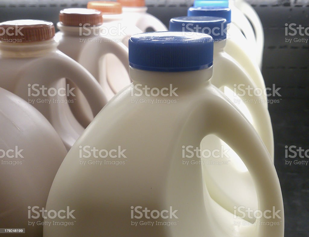 milk bottle on supermarket shelf royalty-free stock photo