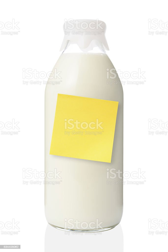 Milk bottle with blank yellow sticky note on white background stock photo