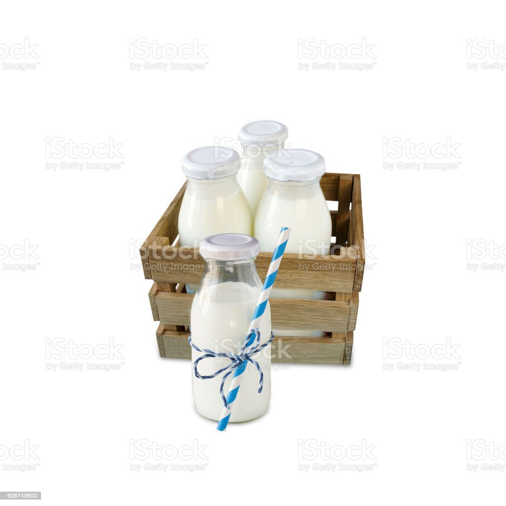 milk bottles in a box isolated on white background stock photo