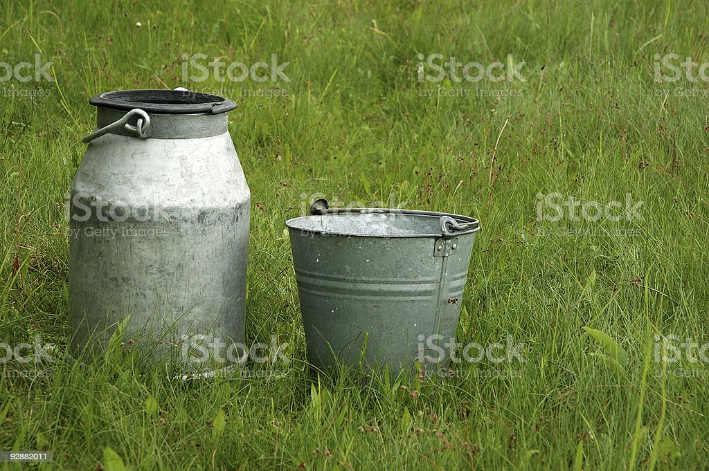 Milk canister & pail stock photo
