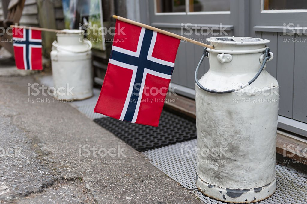 Milk Cans and Norwegian Flags stock photo