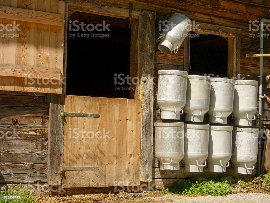 Milk cans at the stable stock photo