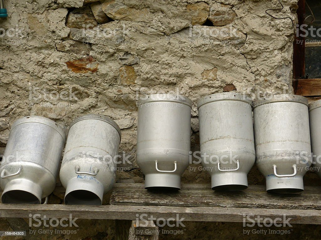 Milk cans on cowshed stock photo