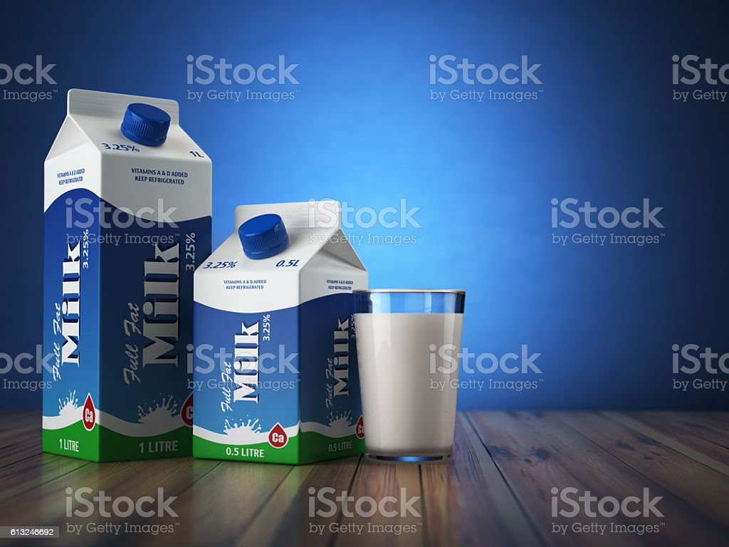 Milk carton packand glass on blue background. stock photo