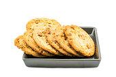 Milk chocolate almond cookies in black plate