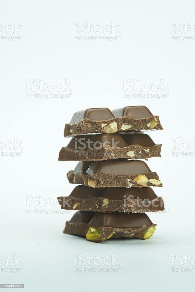 Milk chocolate bar with pistachio royalty-free stock photo