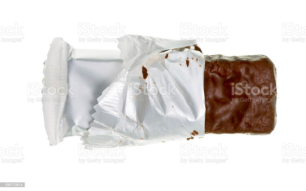 Milk chocolate candy bar in a white wrapper stock photo