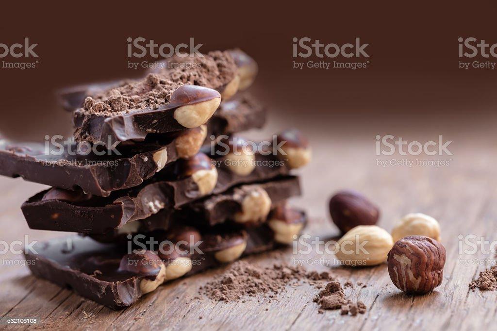 milk chocolate with hazelnuts stock photo