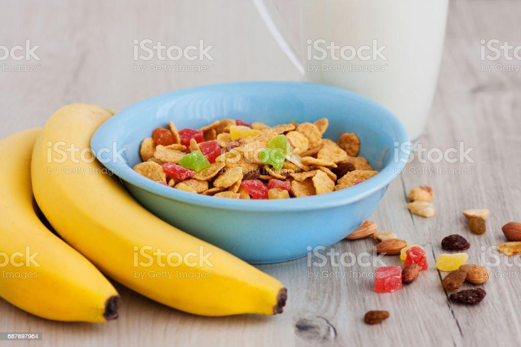 Milk, corn flakes, candied fruits, bananas stock photo