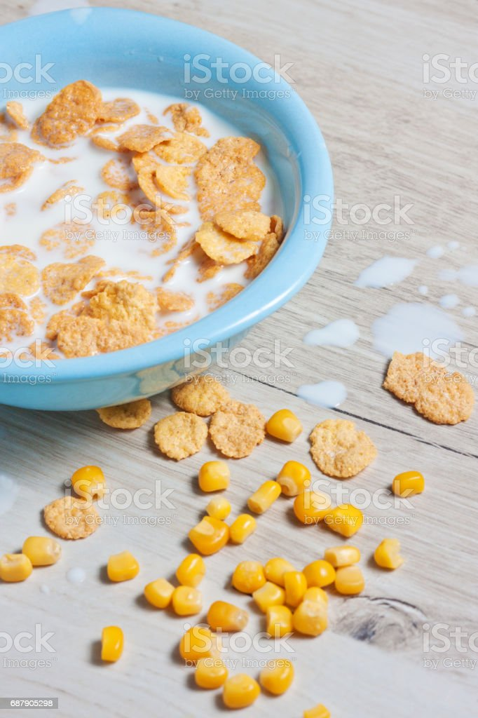 Milk, corn flakes, candied fruits stock photo