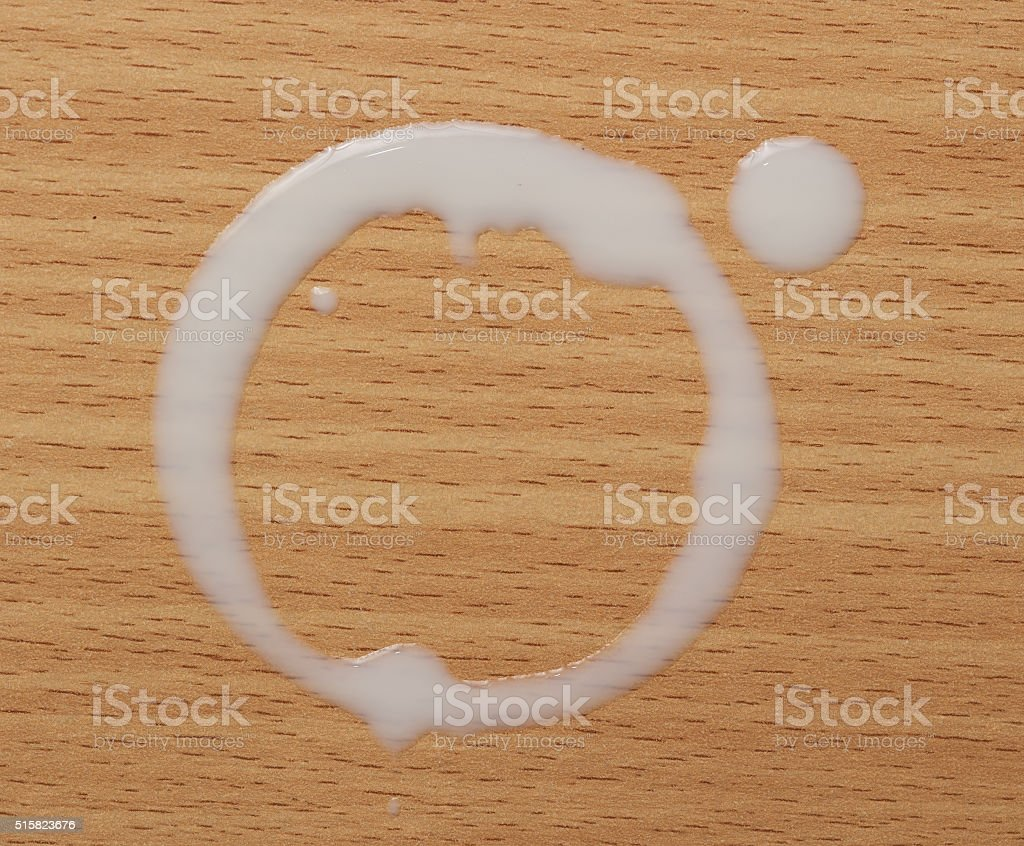 Milk cup rings on wood background. stock photo