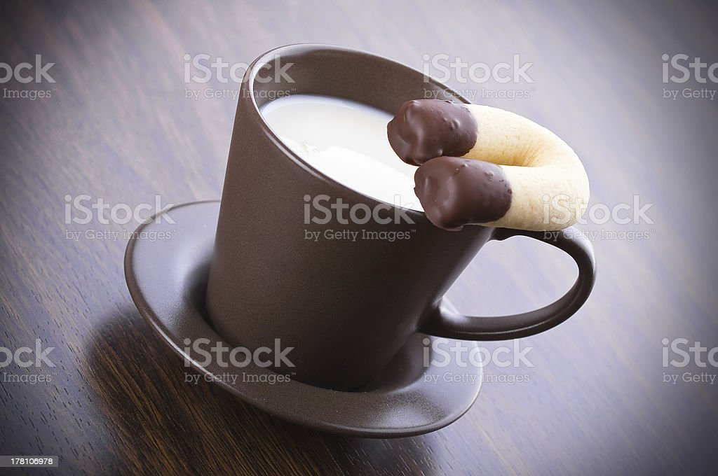 Milk cup with horseshoe cookie. royalty-free stock photo